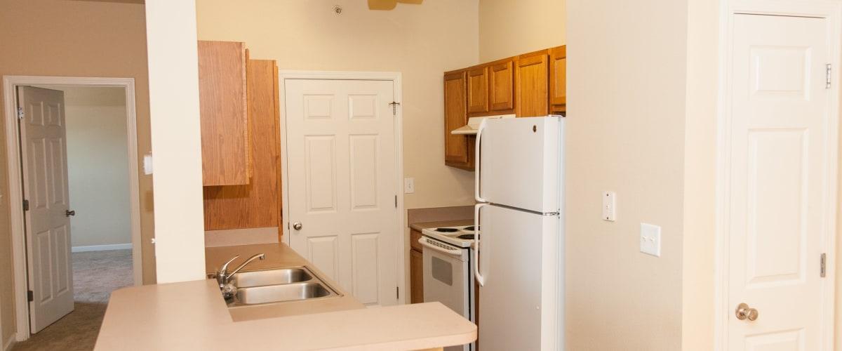 A kitchen with a white fridge at Peine Lakes in Wentzville, Missouri