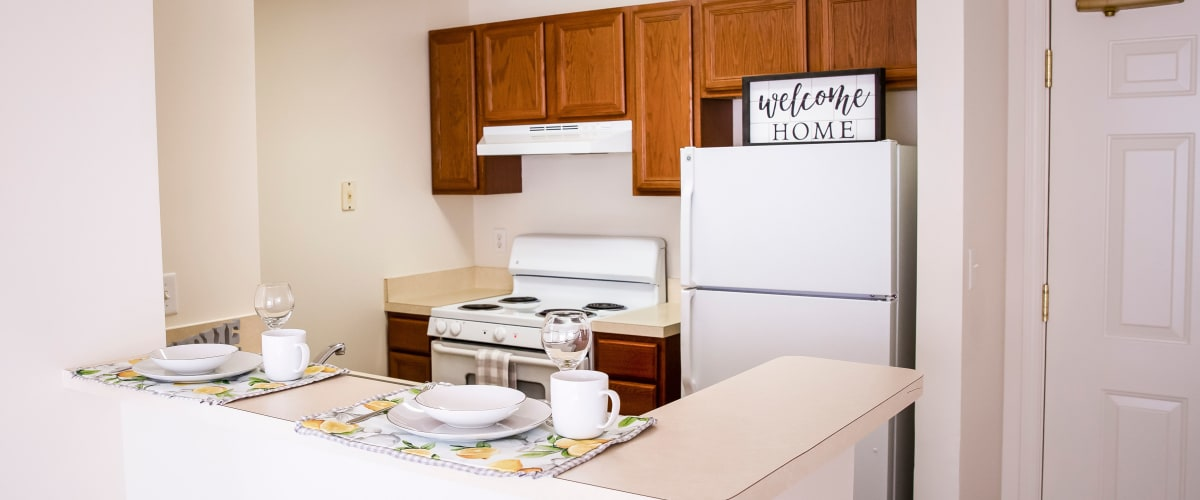 Kitchen with white appliances at Atlantic at Twin Hickory in Glen Allen, Virginia