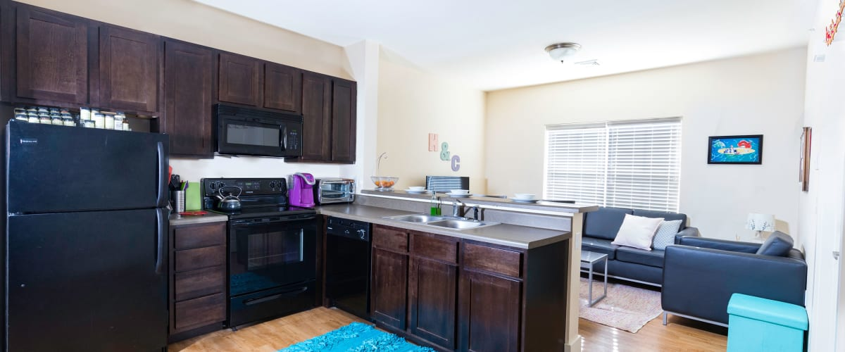A kitchen with black appliances at Beacon Springfield in Springfield, Missouri