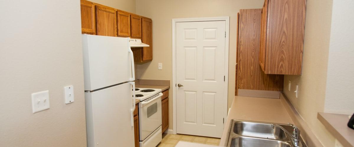 A kitchen with white appliances at O'Fallon Lakes in O'Fallon, Missouri