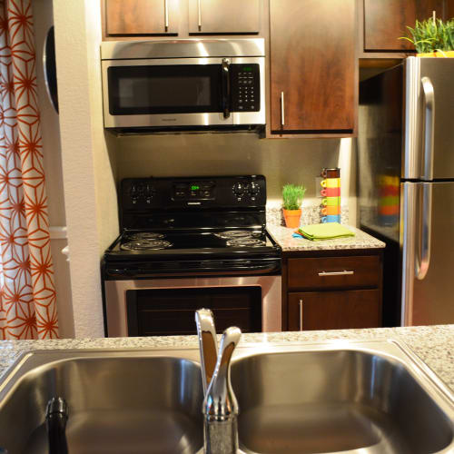 Well-equippe kitchen at The Abbey at Copper Creek apartments