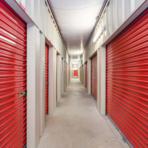Interior units with red doors at Coventry Self Storage in Coventry, Connecticut