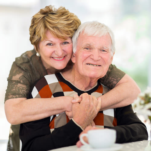 Smiling couple at Wyndham Court of Plano in Plano, Texas