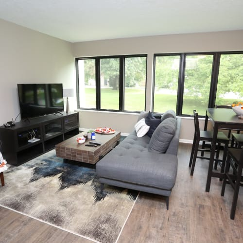 Living room with wood-style flooring at The August Apartments in Lexington, Kentucky