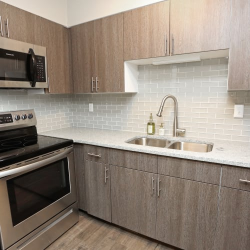 Kitchen with stainless steel appliances at The August Apartments in Lexington, Kentucky