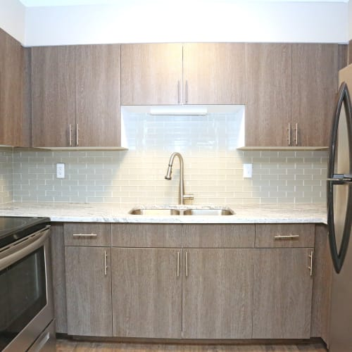 Bright kitchen with plenty of cabinet space at The August Apartments in Lexington, Kentucky