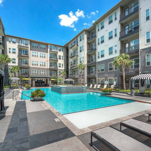 Gorgeous resort-style swimming pool area at Olympus at Ross in Dallas, Texas