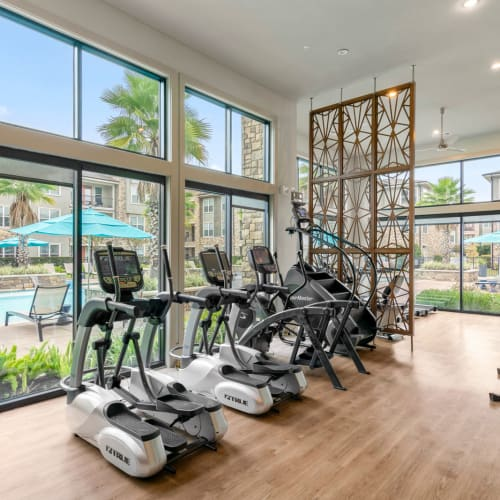 Well-equipped onsite fitness center at Olympus Grand Crossing in Katy, Texas