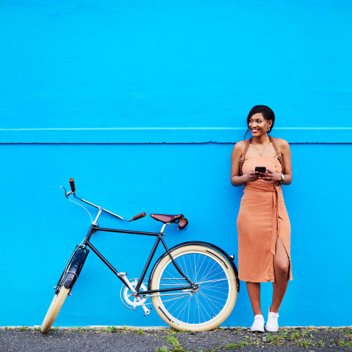 Resident taking a break from her bike ride near Brooklyn Yard in Portland, Oregon