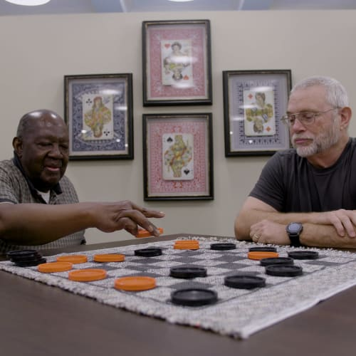 Residents play checkers at Westminster Memory Care in Aiken, South Carolina.