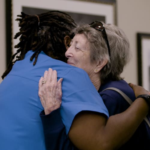 Nurse hugging a resident at Westminster Memory Care in Aiken, South Carolina.