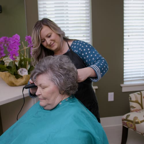 Resident getting a haircut at Westminster Memory Care in Aiken, South Carolina.