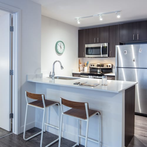 Kitchen with stainless steel appliances at IDENTITY Boise in Boise, Idaho