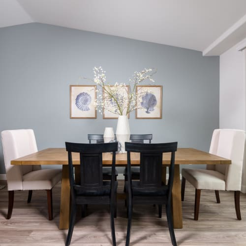 Large dining area with an accent wall in a live/work space  at Portside Ventura Harbor in Ventura, California