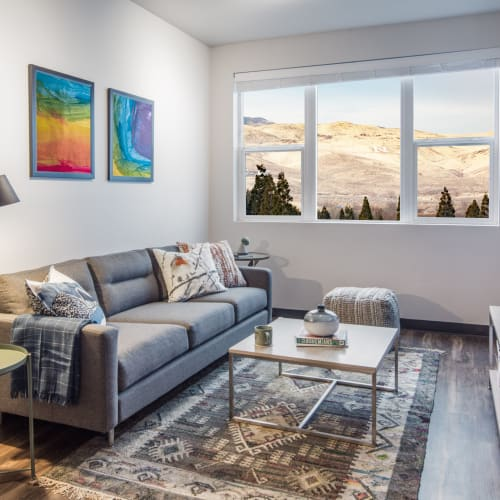 Living room with wood style flooring at IDENTITY Reno in Reno, Nevada