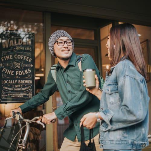 Friends grabbing coffee before class in Reno, Nevada near IDENTITY Reno