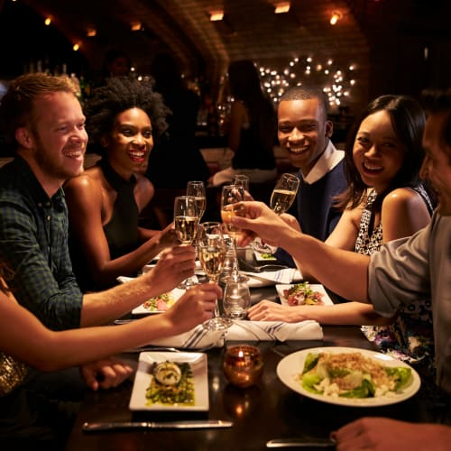 Resident couples out for a night on the town enjoying dinner and drinks near Reserve at Peachtree Corners in Norcross, Georgia
