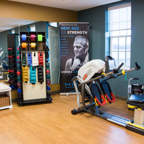 Fitness center with gym equipment at First & Main of Bloomfield Township in Bloomfield Township, Michigan