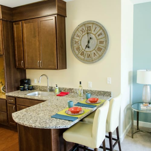 Kitchenettes with granite counter tops available at First & Main of Auburn Hills in Auburn Hills, Michigan