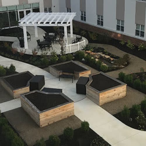 Outdoor courtyard and garden at First & Main of Auburn Hills in Auburn Hills, Michigan