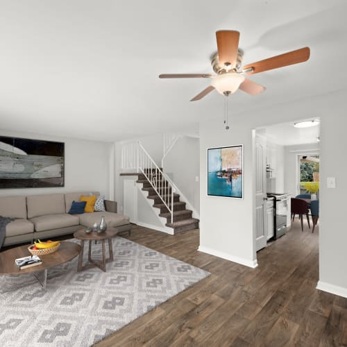 Living room leading to upstairs in model apartment home at The Wesley in Denver, Colorado