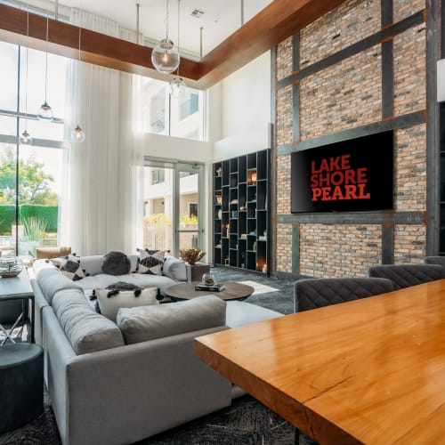 Lounge area with a flatscreen TV in the lobby at Lakeshore Pearl in Austin, Texas