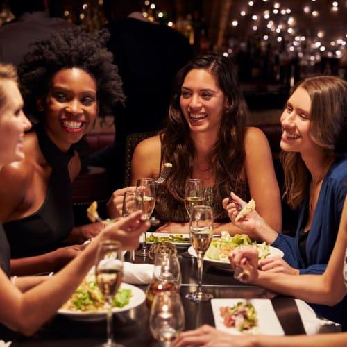 Friends enjoying dinner together near The Alcove in Smyrna, Georgia