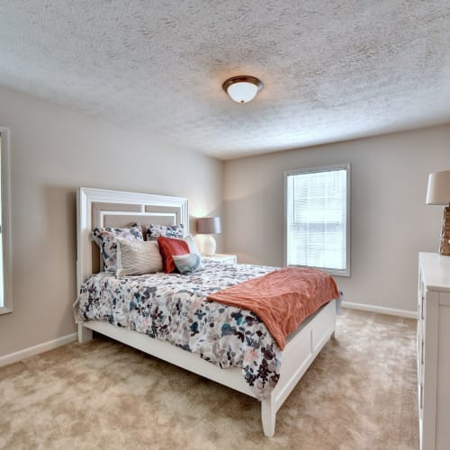 Cozy bedroom at Fields at Peachtree Corners in Norcross, Georgia
