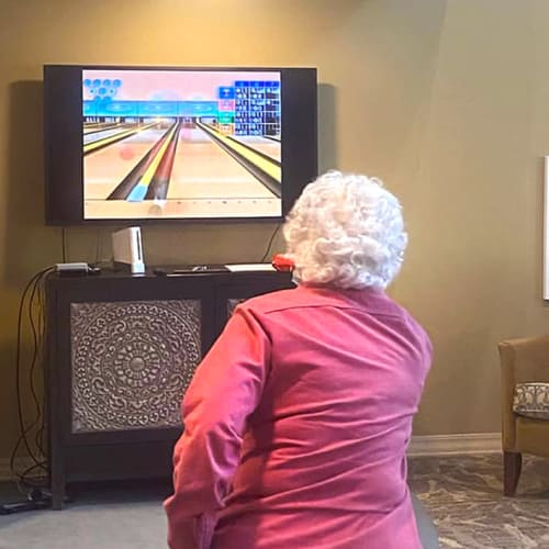 A resident playing wii bowling at The Oxford Grand Assisted Living & Memory Care in Kansas City, Missouri