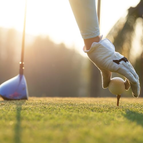 Resident golfing near Courtney Isles in Yulee, Florida