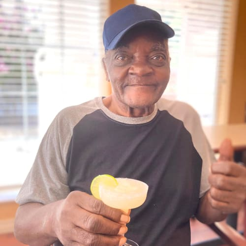 Happy resident snacking at Oxford Senior Living in Wichita, Kansas