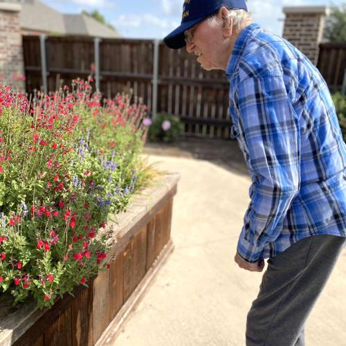 Happy resident in the garden at Oxford Senior Living in Wichita, Kansas