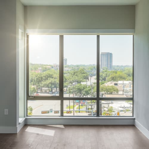 Floor-to-ceiling windows with amazing city views in a model home at Magnolia Heights in San Antonio, Texas