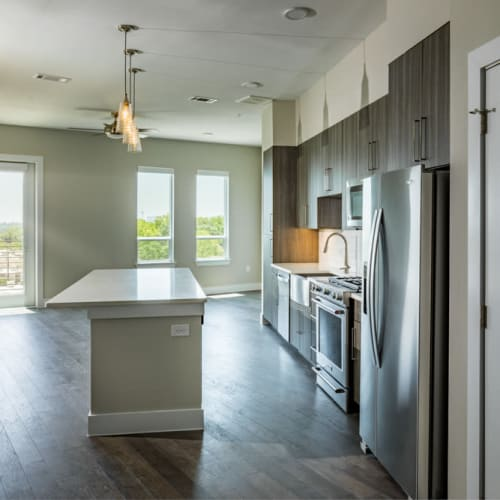 Spacious open-concept model home's kitchen at Magnolia Heights in San Antonio, Texas