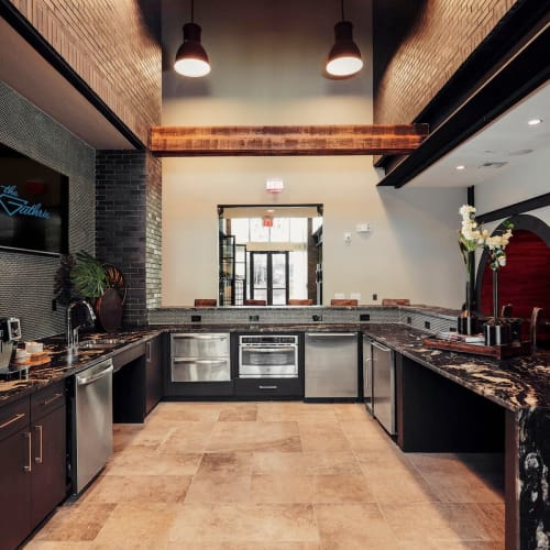 Spacious kitchen in the clubhouse for resident use at The Guthrie in Austin, Texas
