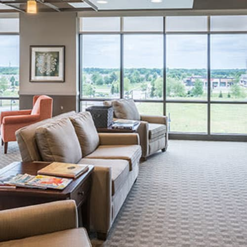 Lounge area with couches at First & Main of Auburn Hills in Auburn Hills, Michigan