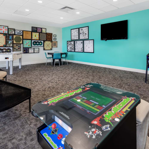 View virtual tour of the resident game room and lounge at Midtown 24 in Plantation, Florida