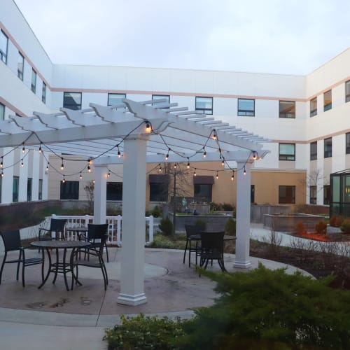 courtyard with pergola and seating at First & Main of Bloomfield Township in Bloomfield Township, Michigan