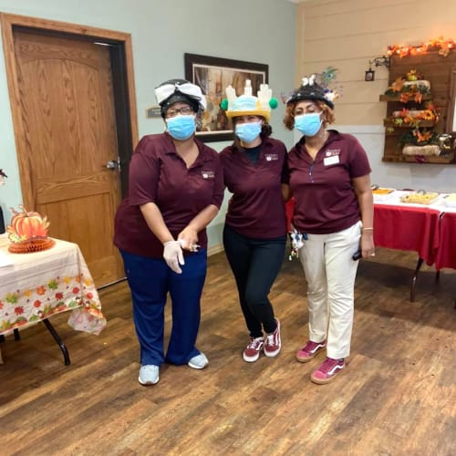 Three team members at Oxford Glen Memory Care at Sachse in Sachse, Texas