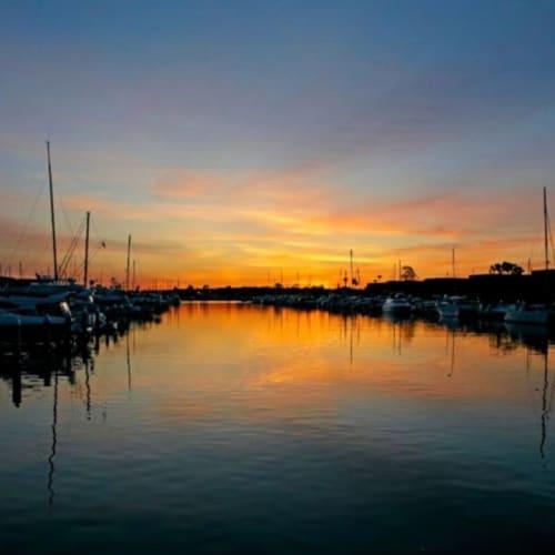 Sunset view of the marina at Marina Harbor in Marina del Rey, California