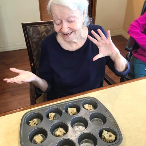 Resident baking at Oxford Glen Memory Care at Grand Prairie in Grand Prairie, Texas