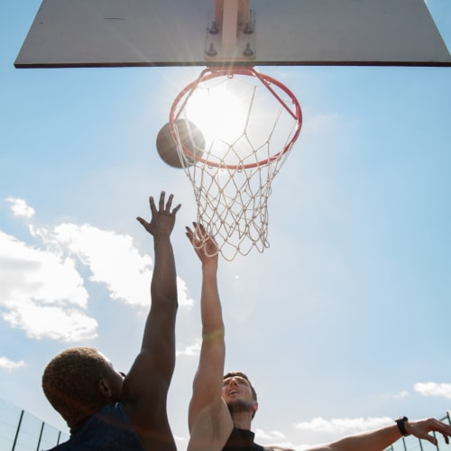 Residents playing a game of basketball at Mandalane Apartments in Wheeling, Illinois