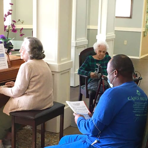 Residents and caretakers singing hymns at Canoe Brook Assisted Living & Memory Care in Catoosa, Oklahoma