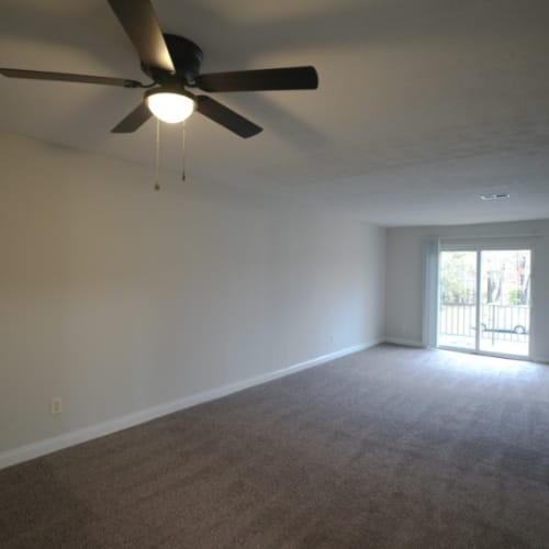 A large living room with patio access at Tanglewood Apartments in Louisville, Kentucky