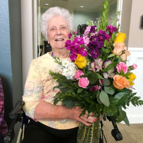 Resident holding flowers at FountainBrook in Midwest City, Oklahoma