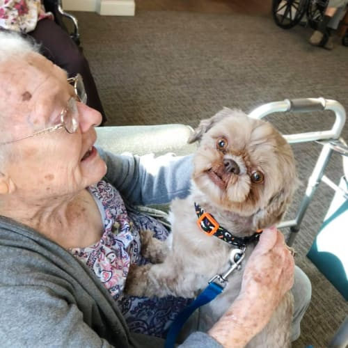 A resident holding a lap dog at FountainBrook in Midwest City, Oklahoma