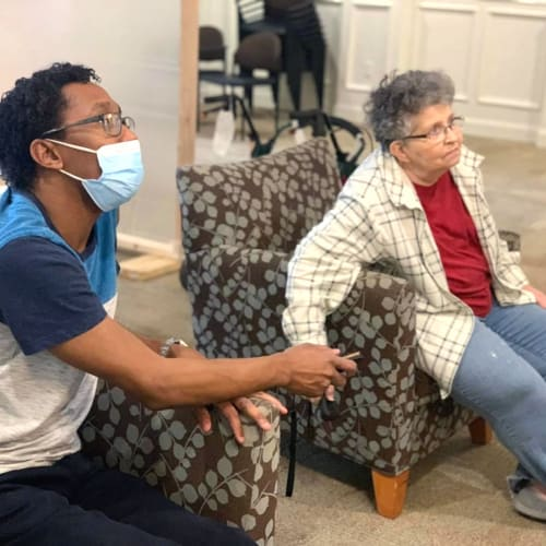 Masked team member with a resident at FountainBrook in Midwest City, Oklahoma