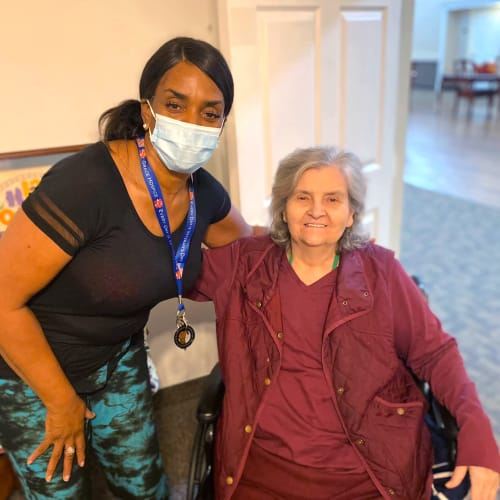 Resident with a masked caretaker at Canoe Brook Assisted Living in Broken Arrow, Oklahoma