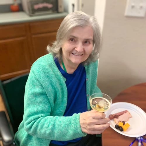 Resident holding a glass of wine at Canoe Brook Assisted Living in Broken Arrow, Oklahoma