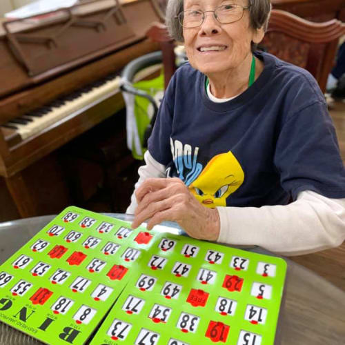 Resident playing bingo at Canoe Brook Assisted Living in Broken Arrow, Oklahoma